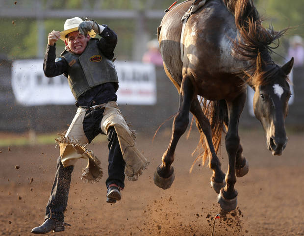 Frank Haskell of Weatherford, Texas, falls off in the bareback bronc competition during the International Finals Youth Rodeo at the Heart of Oklahoma Exposition Center in Shawnee, Okla., Friday, July 13, 2012. Photo by Bryan Terry, The Oklahoman