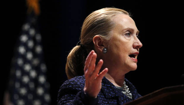 "Secretary of State Hillary Rodham Clinton gestures as she gives a speech: ""Frontlines and Frontiers: Making Human Rights a Human Reality,"" Thursday, Dec. 6, 2012, at Dublin City University in Dublin, Ireland. (AP Photo/Kevin Lamarque, Pool)"