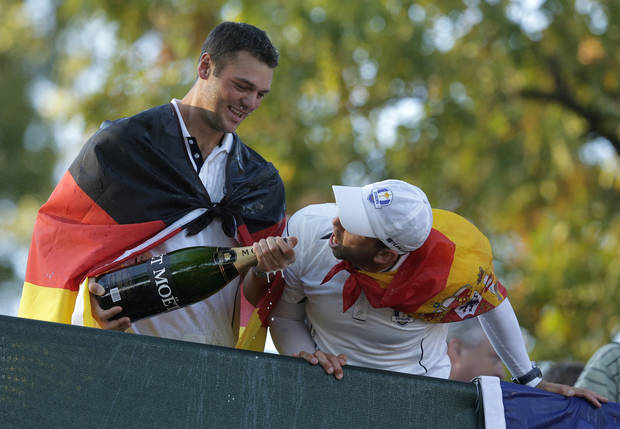 Europe's Martin Kaymer and Sergio Garcia celebrate after winning the Ryder Cup PGA golf tournament Sunday, Sept. 30, 2012, at the Medinah Country Club in Medinah, Ill. (AP Photo/Charlie Riedel)  ORG XMIT: PGA219