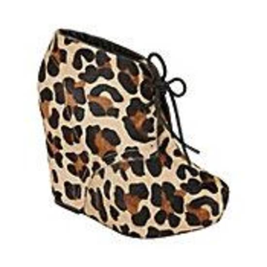 Steve Madden leopard print platform wedge lace-up, $149.95.