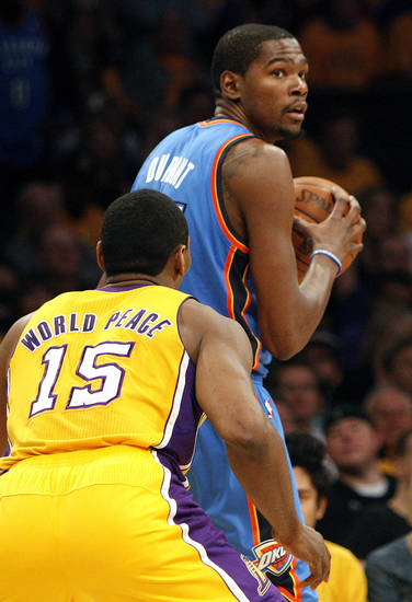 Los Angeles' Metta World Peace (15) defends Oklahoma City's Kevin Durant (35) during Game 3 in the second round of the NBA basketball playoffs between the L.A. Lakers and the Oklahoma City Thunder at the Staples Center in Los Angeles, Friday, May 18, 2012. Photo by Nate Billings, The Oklahoman