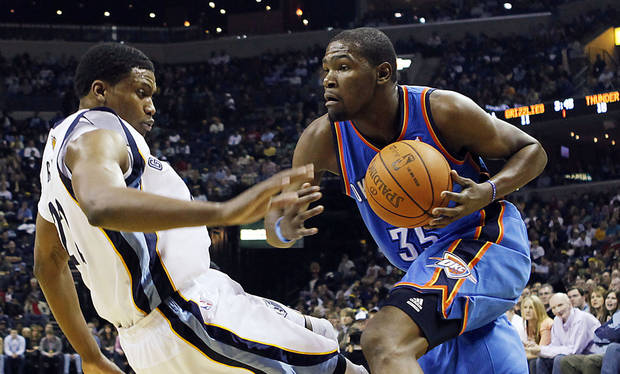 Oklahoma City Thunder forward Kevin Durant (35) goes to the basket against Memphis Grizzlies forward Rudy Gay in the first half of an NBA basketball game Wednesday, Dec. 28, 2011, in Memphis, Tenn. (AP Photo/Lance Murphey) ORG XMIT: TNLM104
