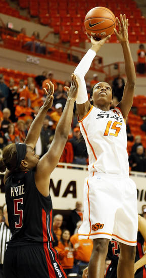 Oklahoma State's Toni Young (15) shoots against Texas Tech's Christine Hyde (5) during a women's college basketball game between Oklahoma State University (OSU) and Texas Tech at Gallagher-Iba Arena in Stillwater, Okla., Wednesday, Jan. 2, 2013. Photo by Nate Billings, The Oklahoman
