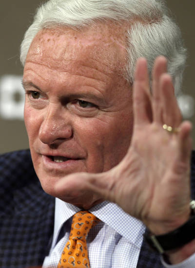 Cleveland Browns owner Jimmy Haslam, right, answers qustions at a news conference announcing Rob Chudzinski as the new head coach at the NFL football team's practice facility in Berea, Ohio Friday, Jan. 11, 2013. (AP Photo/Mark Duncan)