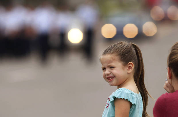 A young girl watches as the parade passes. Carl Albert High School is celebrating its 50th birthday this year and students and alumni participated in homecoming week activities, including a two-mile long parade before the football game on Friday, Oct. 12, 2012.    Photo by Jim Beckel, The Oklahoman