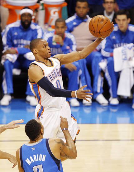 Oklahoma City's Russell Westbrook (0) takes the ball to the hoop past Shawn Marion (0) of Dallas in the first half during game 3 of the Western Conference Finals of the NBA basketball playoffs between the Dallas Mavericks and the Oklahoma City Thunder at the OKC Arena in downtown Oklahoma City, Saturday, May 21, 2011. Photo by Nate Billings, The Oklahoman