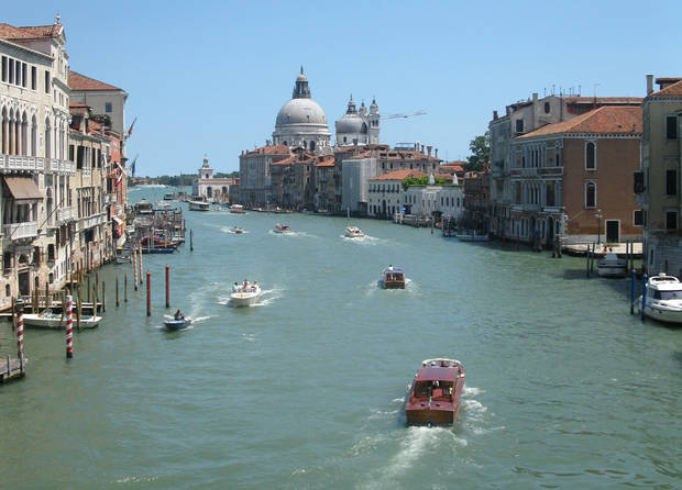This July 17, 2012 photo shows water traffic bustling on the Grande Canale in the heart of Venice, Italy. To travel through northern Italy with a copy of Mark Twain�s 1869 �'The Innocents Abroad', his classic 'record of a pleasure trip'. It took him to the great sights of Europe and on to Constantinople and Jerusalem before he sailed home to New York. Such a trip would take far too big a chunk out of my holiday time. But, Milan, Florence and Venice, a mere fragment for Twain, was within my reach for a two-week vacation. (AP Photo/Raf Casert)