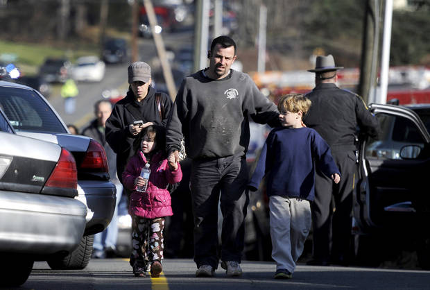 Parents leave a staging area after being reunited with their children following a shooting at the Sandy Hook Elementary School in Newtown, Conn., about 60 miles (96 kilometers) northeast of New York City, Friday, Dec. 14, 2012. An official with knowledge of Friday&#039;s shooting said 27 people were dead, including 18 children. It was the worst school shooting in the country&#039;s history. (AP Photo/Jessica Hill)