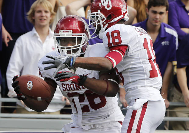 Oklahoma's Damien Williams (26) and Oklahoma's Jalen Saunders (18) celebrate Williams touchdown during the college football game between the University of Oklahoma Sooners (OU) and the Texas Christian University Horned Frogs (TCU) at Amon G. Carter Stadium in Fort Worth, Texas, on Saturday, Dec. 1, 2012. Photo by Steve Sisney, The Oklahoman