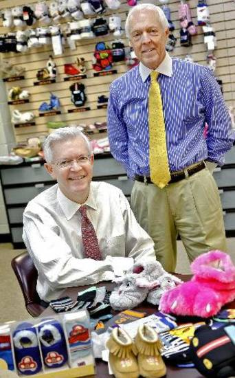 Mark (left) and David McCubbin pose with some of their company products. Photo by Chris Landsberger, The Oklahoman <strong></strong>