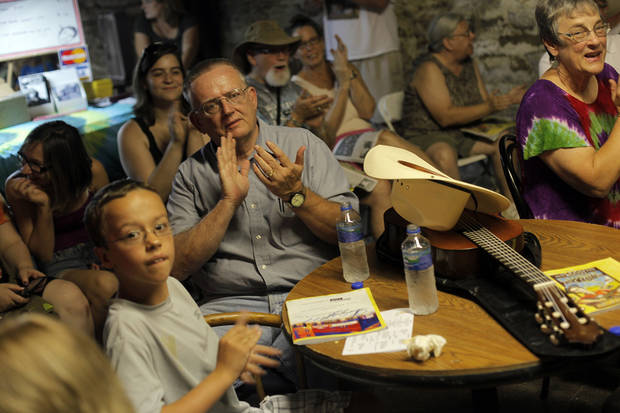 CHILD / CHILDREN / KIDS: Ray Wallace, of Frederick, Okla., watches a show with his grandson, Alex Preston, 9, during the Woody Guthrie Folk Festival in Okemah, Okla., Thursday, July 12, 2012.  Photo by Garett Fisbeck, The Oklahoman