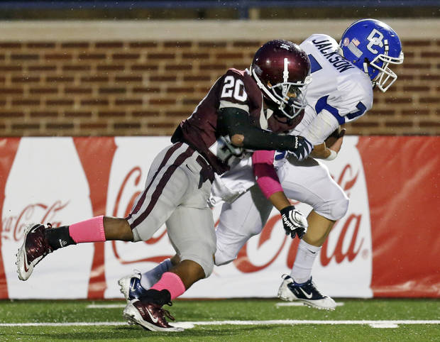 Deer Creek's Kale Jackson (7) gets past the defense of Edmond Memorial's Tyren Lawson (20) on a touchdown reception during a high school football game between Edmond Memorial and Deer Creek at Wantland Stadium in Edmond, Okla., Thursday, Sept. 13, 2012. Photo by Nate Billings, The Oklahoman