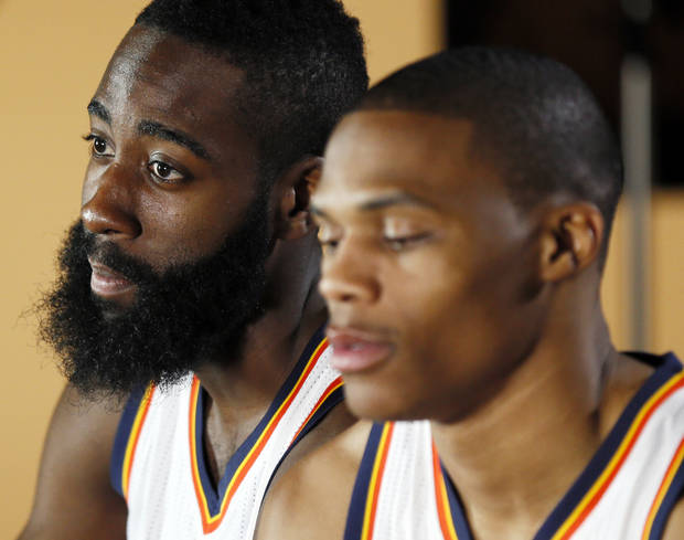 James Harden, left, and Russell Westbrook give a television interview during media day for the Oklahoma City Thunder NBA basketball team at the Thunder Events Center in Oklahoma City, Monday, Oct. 1, 2012.  Photo by Nate Billings, The Oklahoman
