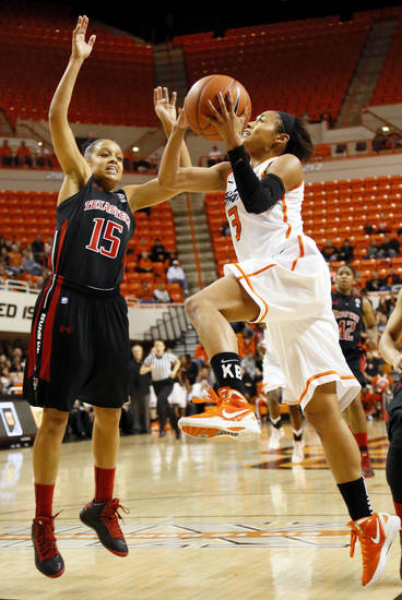 Oklahoma State's Tiffany Bias (3) moves to the hoop against Texas Tech's Casey Morris (15) during a women's college basketball game between Oklahoma State University (OSU) and Texas Tech at Gallagher-Iba Arena in Stillwater, Okla., Wednesday, Jan. 2, 2013. Photo by Nate Billings, The Oklahoman