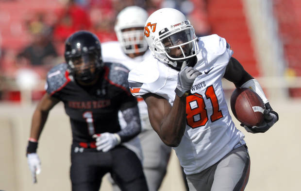 Oklahoma State's Justin Blackmon (81) runs after a catch during a college football game between Texas Tech University (TTU) and Oklahoma State University (OSU) at Jones AT&T Stadium in Lubbock, Texas, Saturday, Nov. 12, 2011.  Photo by Sarah Phipps, The Oklahoman  ORG XMIT: KOD