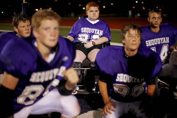Keegan Erbst listens to the coaches during halftime of Sequoyah Middle School football game, Thursday, September 27, 2012. Keegan, who has muscular dystrophy and is confined to a wheelchair, got involved with the team after players Lucas Coker, James Colton, and Parker Tumleson, pushed suggested it to the coach.  Photo by Bryan Terry, The Oklahoman