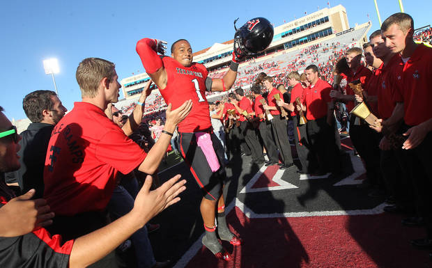 Texas Tech's Terrance Bullitt celebrates after theri 49-14 win over West Virginia in an NCAA college football game in Lubbock, Texas, Saturday, Oct. 13, 2012. (AP Photo/Lubbock Avalanche-Journal, Stephen Spillman) LOCAL TV OUT