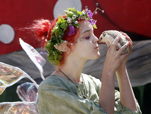 Loxy the Fairy kisses her pet hedgehog during the Medieval Fair at Reaves Park on Friday, April 5, 2013 in Norman, Okla.  Photo by Steve Sisney, The Oklahoman