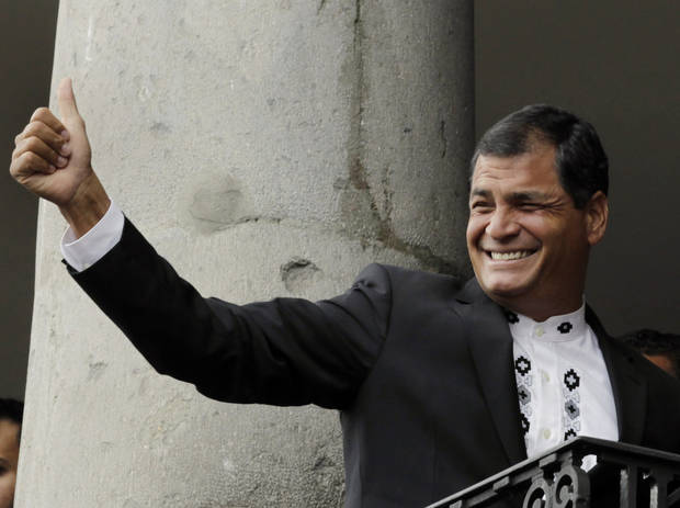 Ecuador's President Rafael Correa gives a thumbs up to supporters as he stands with the Emir of Qatar Sheikh Hamad bin Khalifa al-Thani, not in picture, on a balcony at the government palace in Quito, Ecuador, Saturday, Feb. 16, 2013. Correa is running for another term in tomorrow's presidential election. Members of the National Assembly will also be elected. (AP Photo/Dolores Ochoa)