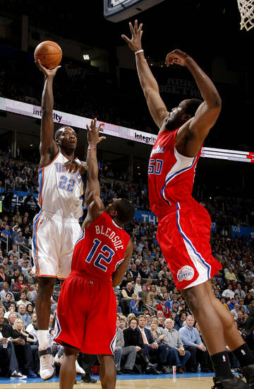 Oklahoma City's Jeff Green (22) shoots the ball over Los Angeles' Eric Bledsoe (12) and Ike Diogu (50) during the NBA basketball game between the Oklahoma City Thunder and the Los Angeles Clippers at the Oklahoma CIty Arena, Tuesday, Feb. 22, 2011.  Photo by Bryan Terry, The Oklahoman