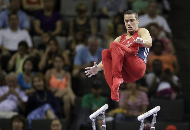 Jake Dalton performs on the parallel bars during the final round of the men&#039;s Olympic gymnastics trials, Saturday, June 30, 2012, in San Jose, Calif.(AP Photo/Jae C. Hong)  ORG XMIT: CAJJ148