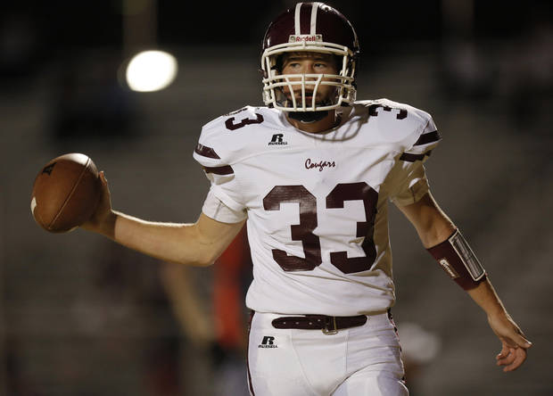 Ada's John Stout (33) tosses a football after scoring a touchdown during a high school football game between Douglass and Ada at Moses F. Miller Stadium in Oklahoma City, Friday, Nov. 2, 2012.  Photo by Garett Fisbeck, The Oklahoman