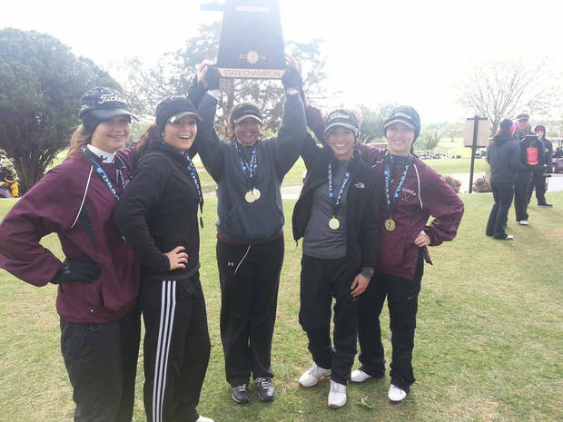 The Eufaula girls celebrate their Class 3A state golf championship. PHOTO BY ED GODFREY, THE OKLAHOMAN KOD