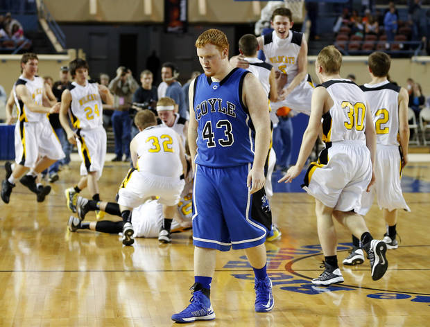 Coyle's Dalton Anderson walks off the court after their loss in the Class B boys state championship game between Coyle and Arnett in the State Fair Arena at State Fair Park in Oklahoma City, Saturday, March 2, 2013. Photo by Bryan Terry, The Oklahoman