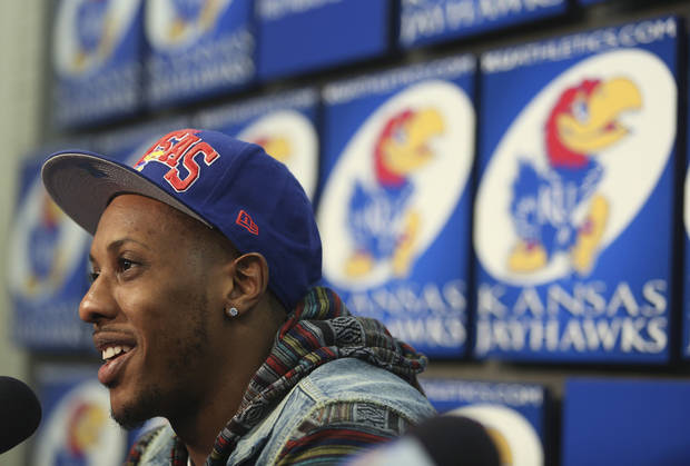 Former Kansas player Mario Chalmers and current member of the Miami Heat talks to the media prior to a Kansas college basketball game against Texas,Saturday, Feb. 16, 2013, in Lawrence, Kan. Chalmers' jersey is to be retired during halftime at the game. (AP Photo/Ed Zurga)