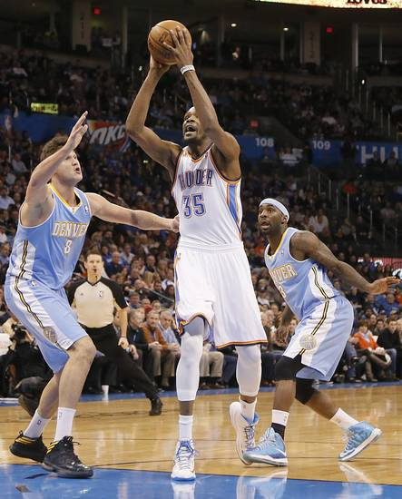 Oklahoma City's Kevin Durant (35) shoots the ball past Denver's Danilo Gallinari (8) and Ty Lawson (3) during the NBA basketball game between the Oklahoma City Thunder and the Denver Nuggets at the Chesapeake Energy Arena on Wednesday, Jan. 16, 2013, in Oklahoma City, Okla.  Photo by Chris Landsberger, The Oklahoman