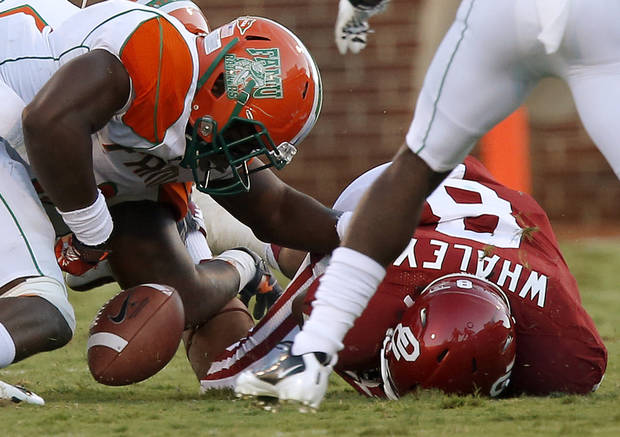 Oklahoma's Dominique Whaley (8) fumbles the ball beside Florida A&M's Brandon Denmark (8) during the college football game between the University of Oklahoma Sooners (OU) and Florida A&M Rattlers at Gaylord Family-Oklahoma Memorial Stadium in Norman, Okla., Saturday, Sept. 8, 2012. Photo by Bryan Terry, The Oklahoman