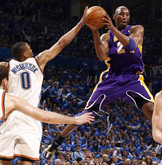 NBA PLAYOFFS / L.A. LAKERS: L.A.'s Kobe Bryant (24) looks to pass as Oklahoma City's Russell Westbrook (0) defends during the NBA basketball game between the Los Angeles Lakers and the Oklahoma City Thunder in game six of the first round series at the Ford Center in Oklahoma City, Friday, April 30, 2010. Photo by Sarah Phipps, The Oklahoman ORG XMIT: KOD