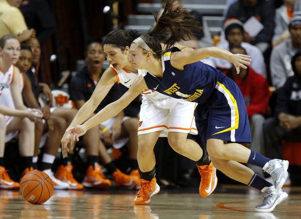 Oklahoma State's Brittney Martin (22) and West Virginia's Brooke Hampton (4) go for the ball during a women's college basketball game between Oklahoma State and West Virginia at Gallagher-Iba Arena in Stillwater, Okla.,  Tuesday, Jan. 29, 2013. Photo by Bryan Terry, The Oklahoman