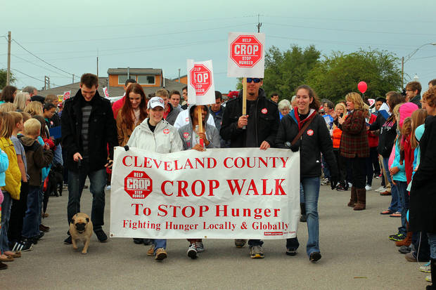 Hundreds line the pavement Sunday as participants in the annual Cleveland County CROP Walk to Stop Hunger start the three-mile course.