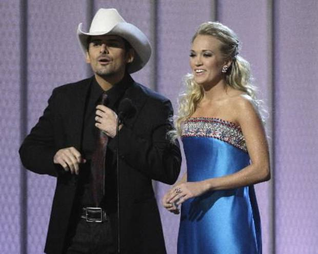 Brad Paisley and Carrie Underwood first co-hosted the Country Music Association Awards in 2008. The CMA announced the stars will reunite to host this year's show in November. (Associated Press file)