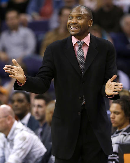 Phoenix Suns coach Lindsey Hunter motions to his team during the first half of an NBA basketball game against the Dallas Mavericks, Friday, Feb. 1, 2013, in Phoenix. (AP Photo/Matt York)