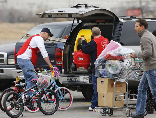 Bicycles and toys are loaded into a vehicle in the parking lot of Crossroads Mall. The Salvation Army and Feed the Children teamed to distribute bicycles and toys for children,  and handed out boxes of food for families at their annual distribution event Wednesday, Dec. 19, 2012. Salvation Army officials said 100 volunteers helped make the event go smoothly. The volunteers loaded bags of toys and bikes into vehicles of clients who had been pre-approved for assistance.  Many of the gifts were provided through the Salvation Army's Angel Tree program   Photo by Jim Beckel, The Oklahoman