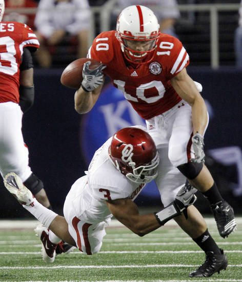 Oklahoma's Jonathan Nelson (3) tires to bring down Nebraska's Roy Helu Jr. (10) during the Big 12 football championship game between the University of Oklahoma Sooners (OU) and the University of Nebraska Cornhuskers (NU) at Cowboys Stadium on Saturday, Dec. 4, 2010, in Arlington, Texas.  Photo by Chris Landsberger, The Oklahoman
