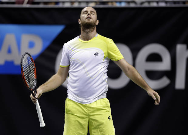 Xavier Malisse, of Belgium, reacts after losing a point to John Isner during the SAP Open tennis tournament in San Jose, Calif., Friday, Feb. 15, 2013. Isner won the match 7-6 (8), 6-2. (AP Photo/Marcio Jose Sanchez)