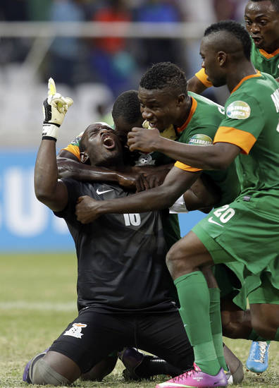 Zambia's goalkeeper Kennedy Mweene, left, celebrates after scoring from the penalty spot a goal against Nigeria during their African Cup of Nations group C match Friday, Jan. 25 2013 at the Mbombela stadium in Nelspruit, South Africa. The two other teams in group C are Ethiopia and Burkina Faso. (AP Photo/Armando Franca)