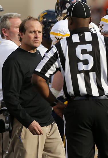 West Virginia head coach Dana Holgorsen talks to an official during a college football game between Oklahoma State University (OSU) and West Virginia University (WVU) at Boone Pickens Stadium in Stillwater, Okla., Saturday, Nov. 10, 2012. Photo by Nate Billings, The Oklahoman