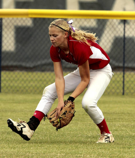 Collinsville outfielder Sam Smith catches a fly against Carl Albert at the 2012 State Fast-Pitch Softball Tournament on Thursday, Oct. 11, 2012 at ASA Hall of Stadium in Oklahoma City, Okla.  Photo by Steve Sisney, The Oklahoman