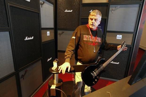 "Project Manager Tom Ford demonstrates one of the interactive guitar stations that is part of the new traveling exhibit ""The Science of Rock 'm' Roll"" at Science Museum Oklahoma in Oklahoma City, OK, on Monday, February 3, 2014, Photo by Paul Hellstern, The Oklahoman"