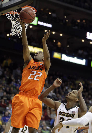 Oklahoma's Markel Brown (22) shoots as Missouri's Kim English (24) defends