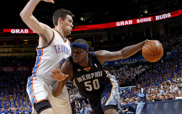 Memphis' Zach Randolph (50) goes past Nick Collison (4) during Game 2 in the second round of the NBA playoffs between the Oklahoma City Thunder and the Memphis Grizzlies at Chesapeake Energy Arena in Oklahoma City, Tuesday, May 7, 2013. Oklahoma  City lost 99-93. Photo by Bryan Terry, The Oklahoman