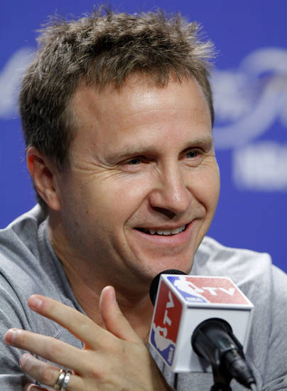 Oklahoma City coach Scott Brooks answers a question during a press conference for Game 5 of the NBA Finals between the Oklahoma City Thunder and the Miami Heat at American Airlines Arena, Wednesday, June 20, 2012. Photo by Bryan Terry, The Oklahoman