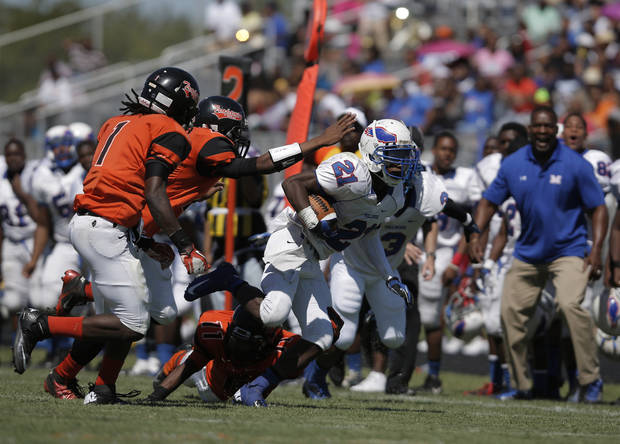 Milwood's Janari Glover (21) runs the ball during a high school football game between Douglass and Millwood in Oklahoma City, Saturday, Sept. 8, 2012.  Photo by Garett Fisbeck, The Oklahoman