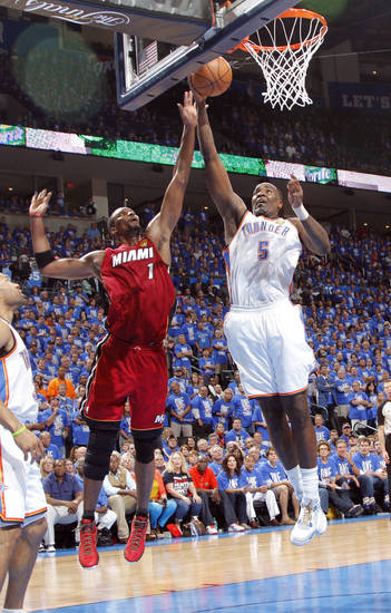 Oklahoma City 's Kendrick Perkins (5) tries to get past Miami's Chris Bosh (1) during Game 1 of the NBA Finals between the Oklahoma City Thunder and the Miami Heat at Chesapeake Energy Arena in Oklahoma City, Tuesday, June 12, 2012. Photo by Chris Landsberger, The Oklahoman