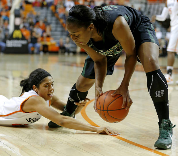 Oklahoma State's Brittney Martin (22) goes for the ball under Baylor's Brooklyn Pope (32) during a women's college basketball game between Oklahoma State University and Baylor at Gallagher-Iba Arena in Stillwater, Okla., Saturday, Feb. 2, 2013. Photo by Bryan Terry, The Oklahoman
