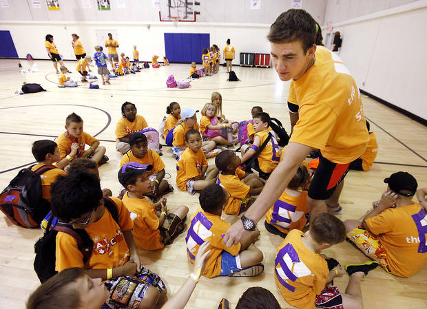Counselor John Kastner says he tries to share a positive attitude with day campers at the Edmond branch of the YMCA. Photos by David McDaniel, The Oklahoman